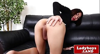 Solo ladyboy tugging and stroking her dick